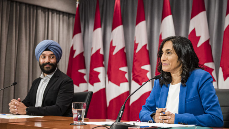Navdeep Bains, Minister of Innovation, Science and Industry and Anita Anand, Minister of Public Services and Procurement, make an announcement about vaccine procurement, in Toronto, on Aug., 5, 2020 (CP/Christopher Katsarov)