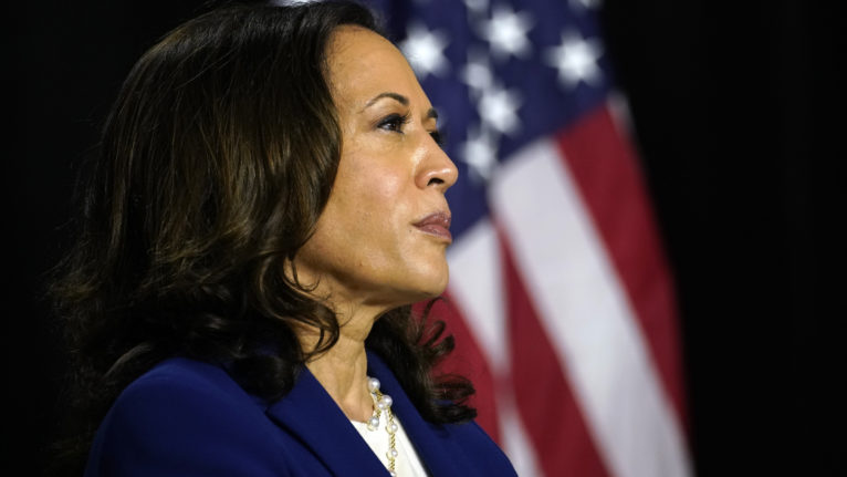 Sen. Kamala Harris, D-Calif., listens as Democratic presidential candidate former Vice President Joe Biden introduces her as his running mate in Wilmington, Del. on Aug. 12, 2020. (Carolyn Kaster/AP/CP)