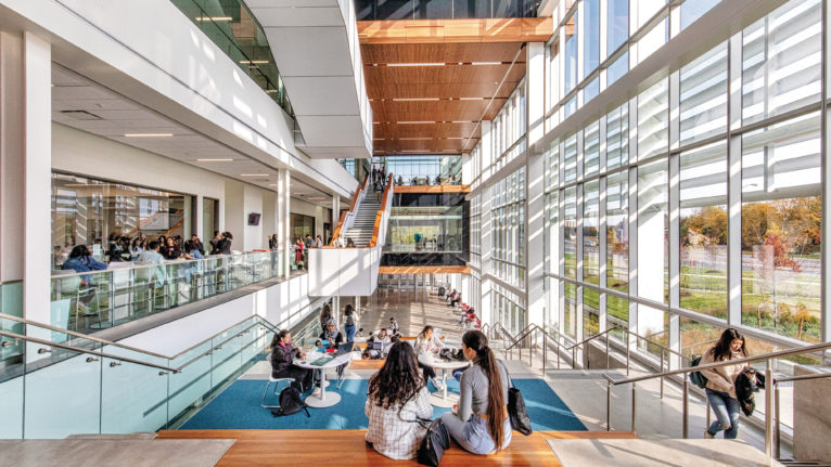 Students sit indoors on Seneca campus