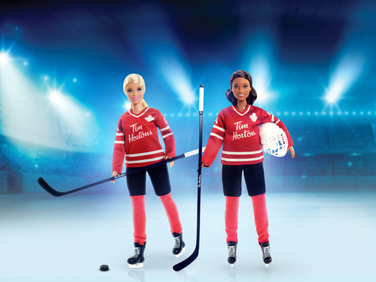 A spokeswoman for Tim Hortons says its restaurants won't be selling a new Barbie made in collaboration with the coffee chain until both Black and white versions of the hockey-themed dolls, seen in an undated handout photo, are available. (Tim Hortons/CP)