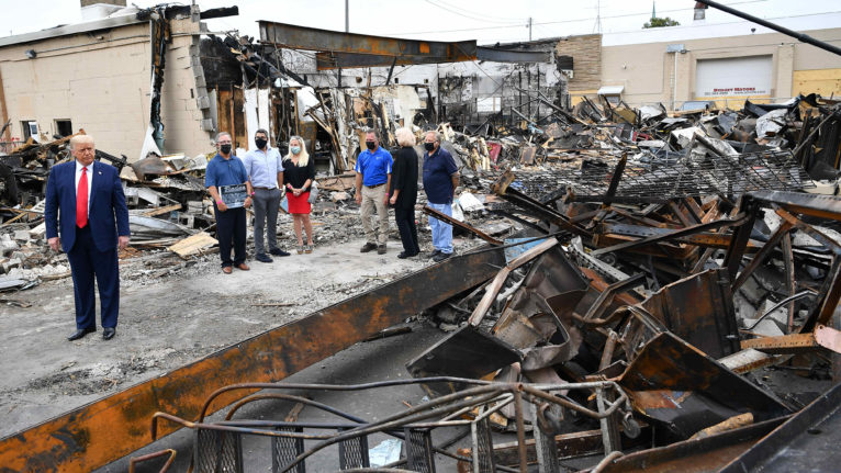 US President Donald Trump tours an area affected by civil unrest in Kenosha, Wisconsin on September 1, 2020. - Trump said Tuesday on a visit to protest-hit Kenosha, Wisconsin that recent anti-police demonstrations in the city were acts of