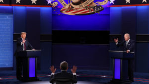 U.S. President Donald Trump and Democratic presidential nominee Joe Biden participate in the first presidential debate moderated by Fox News anchor Chris Wallace (C) at the Health Education Campus of Case Western Reserve University on September 29, 2020 in Cleveland, Ohio. This is the first of three planned debates between the two candidates in the lead up to the election on November 3. (Scott Olson/Getty Images)