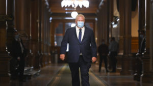 Ontario Premier Doug Ford walks down a hallway at Queen's Park before making an announcement during the COVID-19 pandemic in Toronto on Thursday, September 24, 2020. THE CANADIAN PRESS/Nathan Denette