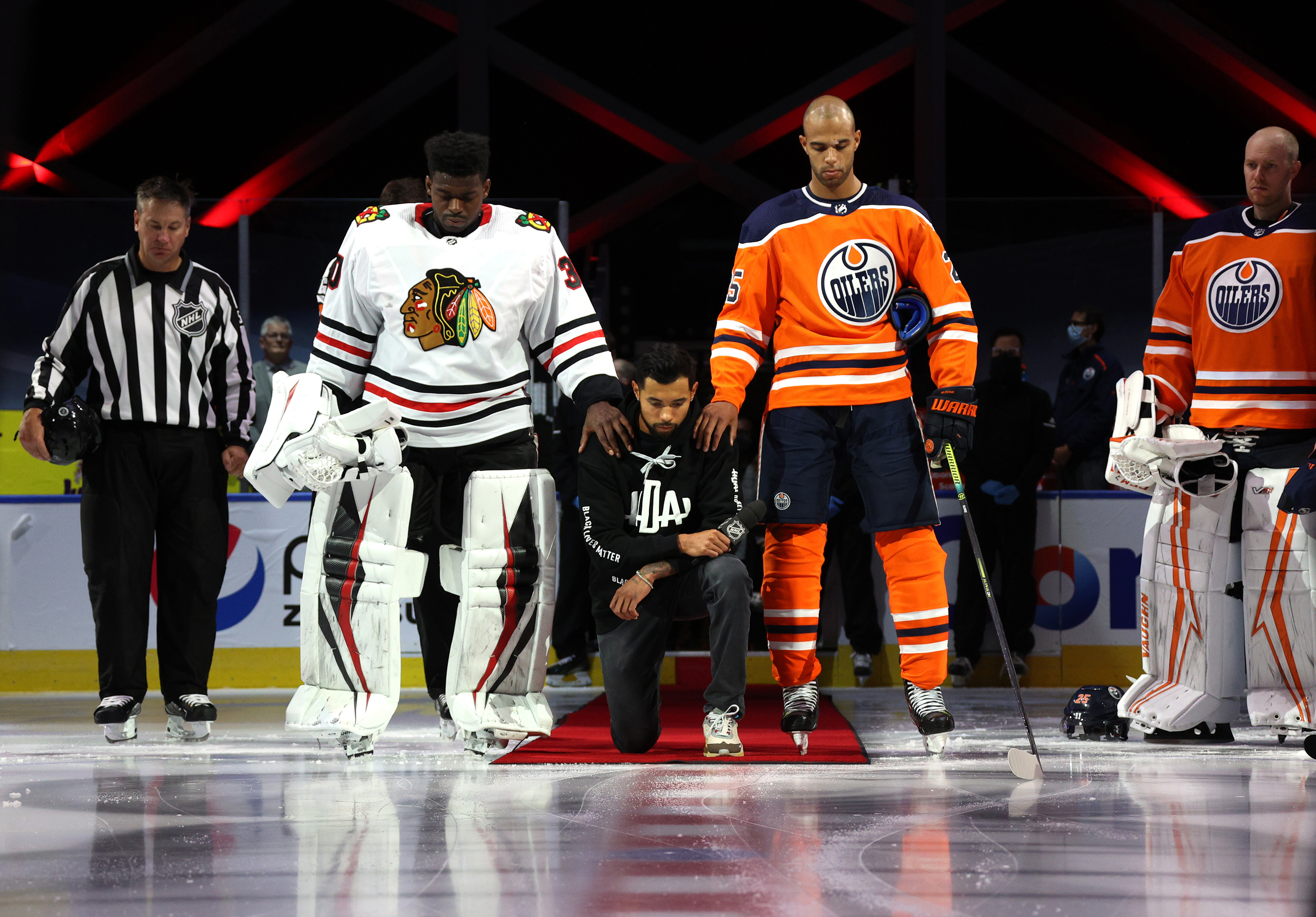 On Aug. 1, Dumba, a Filipino-Canadian player, became the first NHLer to take a knee, with support from Subban (left) and Nurse (Dave Sandford/NHLI/Getty Images)