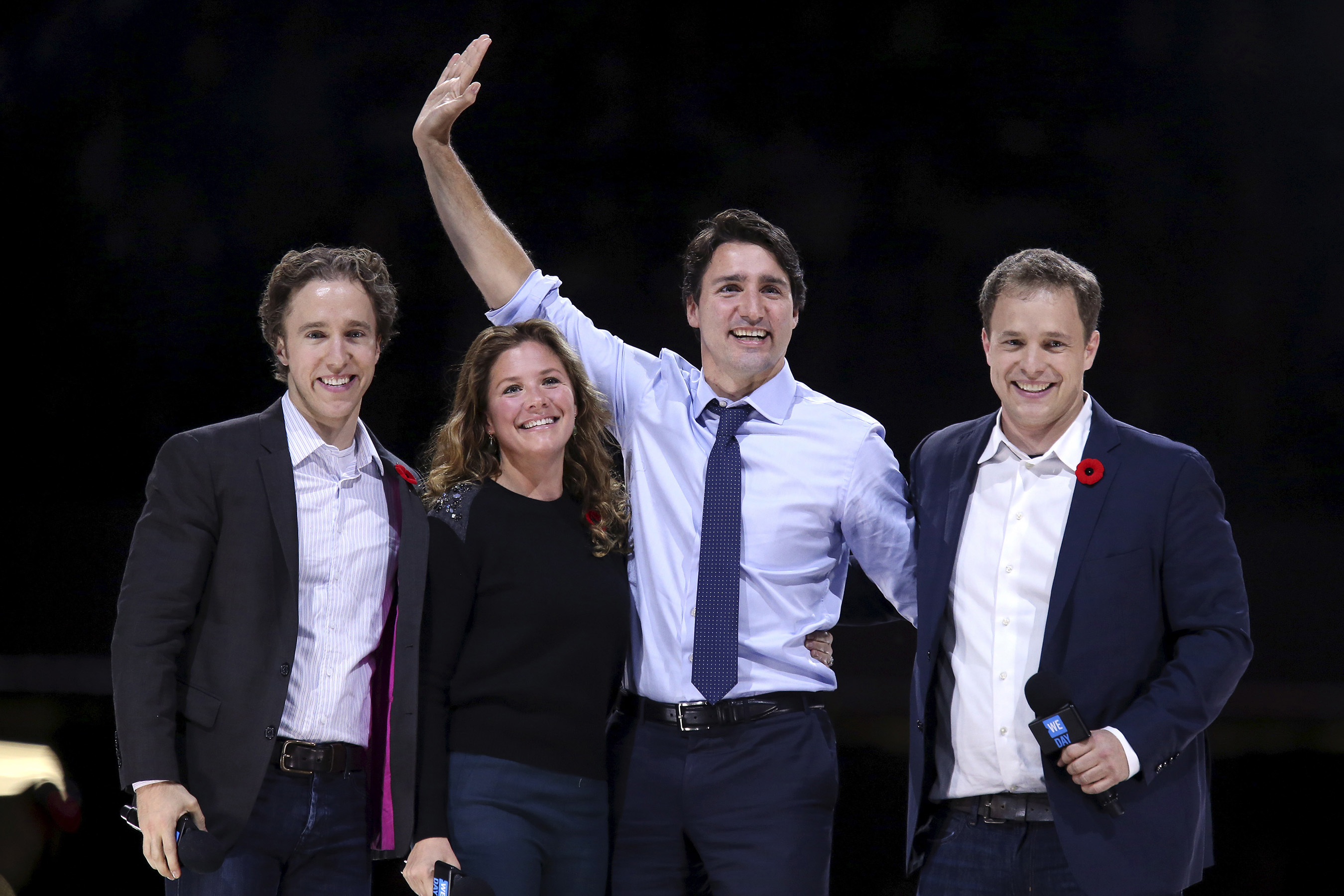 Craig, Grégoire Trudeau, the PM and Marc onstage for a WE Day in Ottawa in 2015 (Chris Wattie/Reuters)