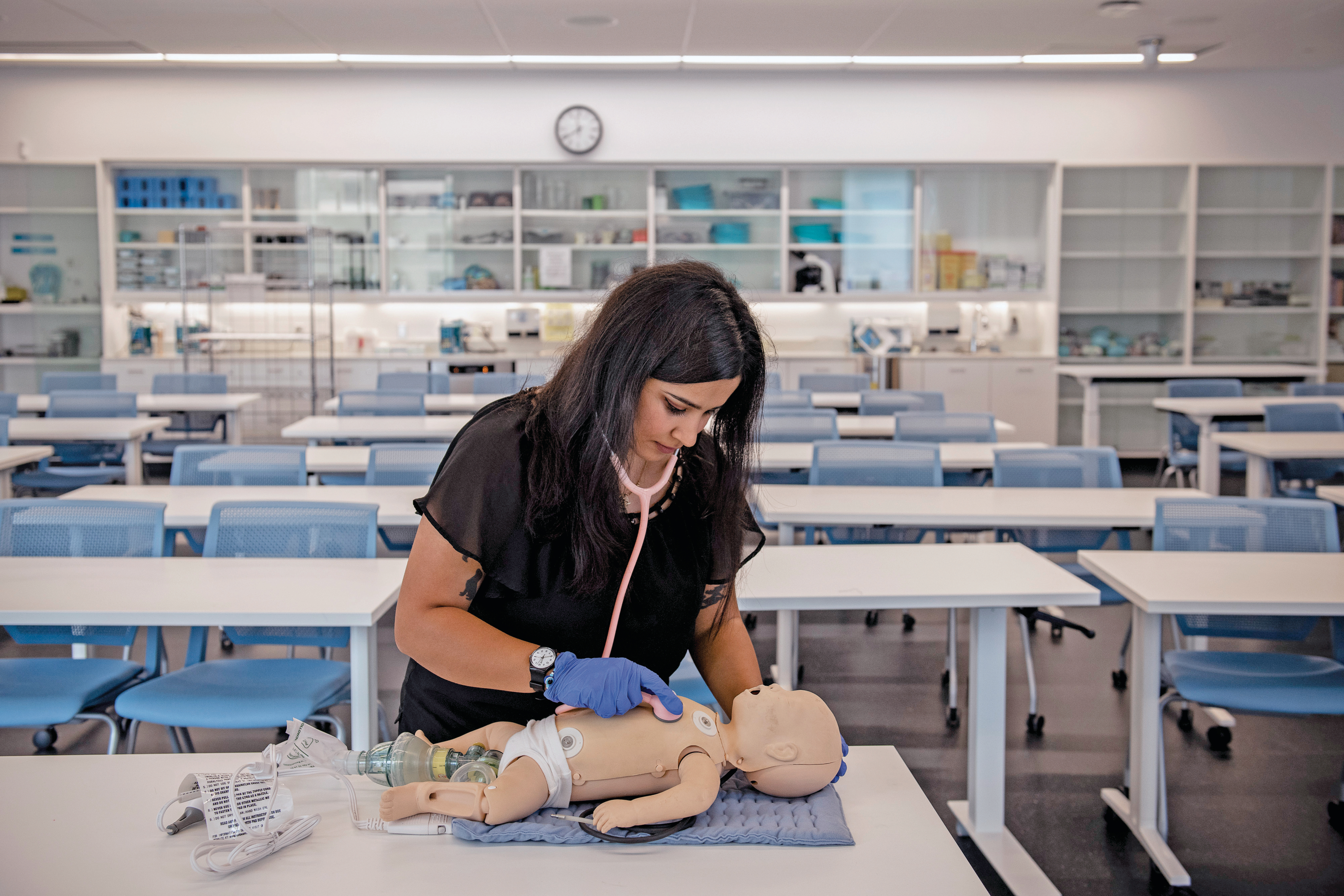 Maryam performs a mock checkup on a doll (Photograph by Kiana Hayeri)