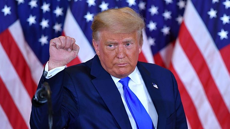 TOPSHOT - US President Donald Trump pumps his fist after speaking during election night in the East Room of the White House in Washington, DC, early on November 4, 2020. (Photo by MANDEL NGAN / AFP) (Photo by MANDEL NGAN/AFP via Getty Images)