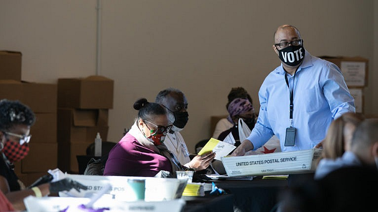 Election workers count Fulton County ballots at State Farm Arena on Nov. 4, 2020 in Atlanta, Georgia (Jessica McGowan/Getty Images)
