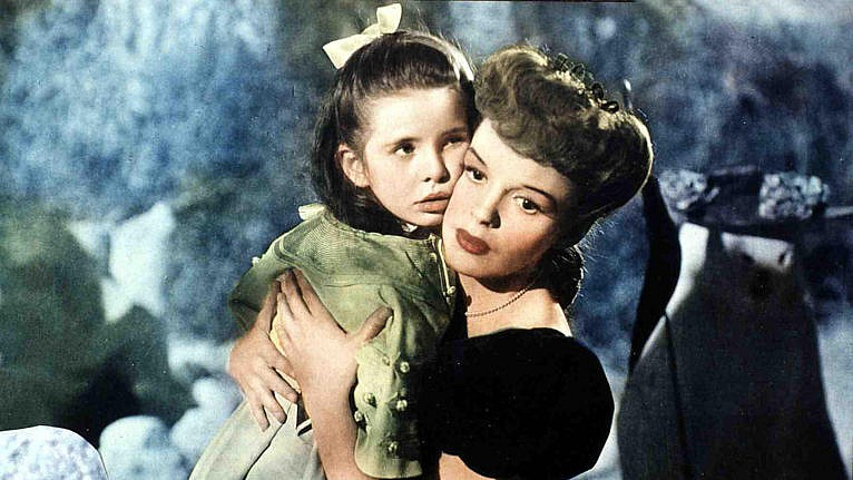 American actor and singer Judy Garland (1922 - 1969) holds Margaret O'Brien in a still from the film, 'Meet Me in St. Louis,' directed by Vincente Minnelli, 1944. (FilmPublicityArchive/United Archives/Getty Images)