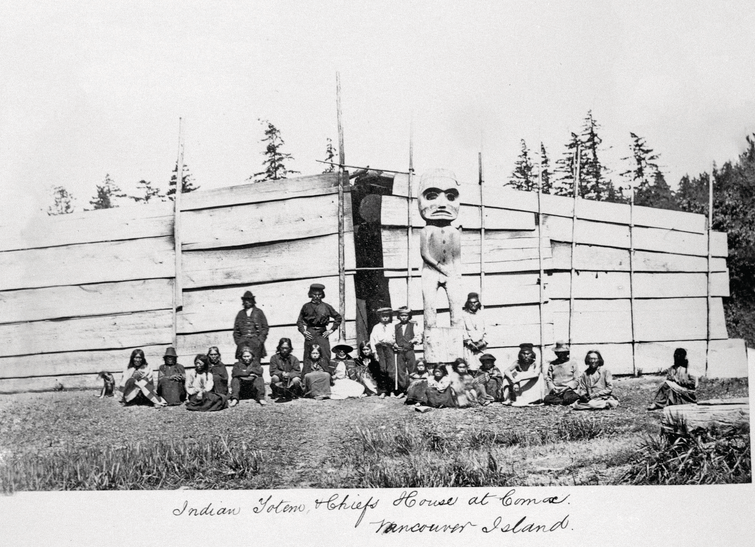 A photo taken outside a chief's house in the Comox area sometime between 1866 and 1870 (Image C-09265 courtesy of the Royal BC Museum)