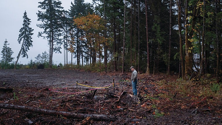 McKay stands near the taped-off area where his excavator turned up a human skull (Photograph by Jen Osborne)