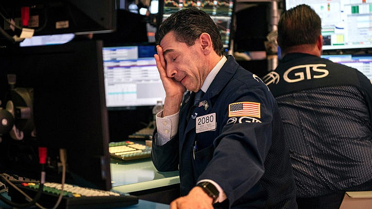 Traders at the NYSE in late February; fears over COVID prompted a stock market plunge (Scott Heins/Getty Images)