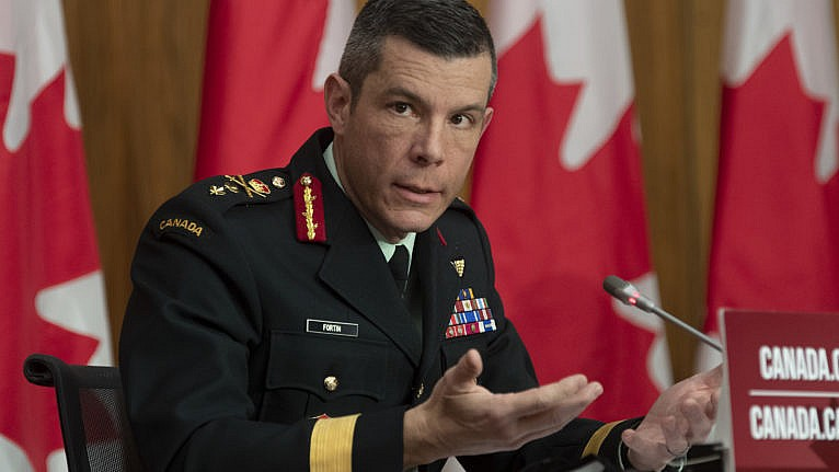 Major General Dany Fortin responds to a question during a news conference in Ottawa, Monday, Dec. 7, 2020. THE CANADIAN PRESS/Adrian Wyld