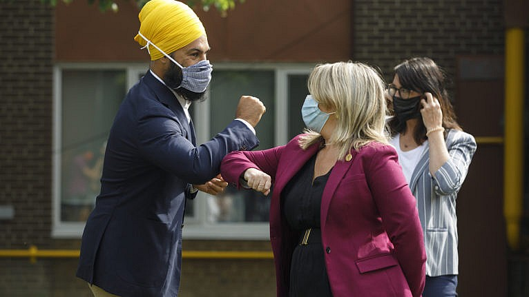 NDP Leader Jagmeet Singh and Ontario NDP MPP Marit Stiles bump elbows after a press conference on the federal and provincial government's back to school plans, in Toronto, Aug. 26, 2020 (CP/Cole Burston)