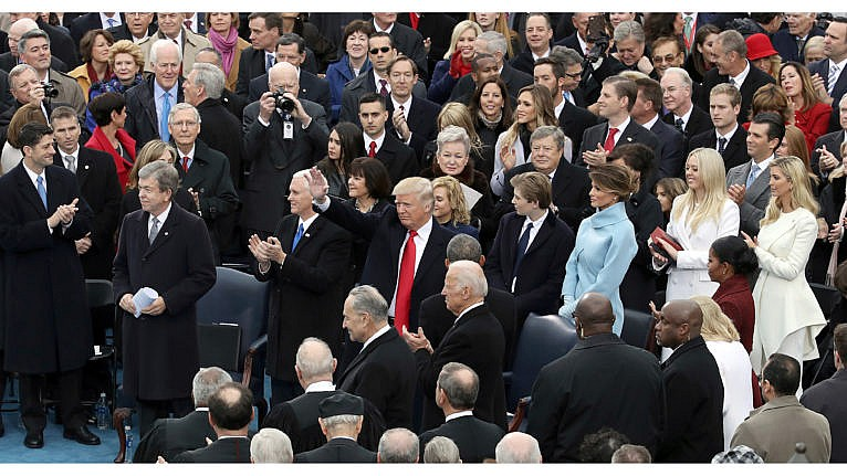U.S. President-elect Donald Trump (C) arrives on the West Front of the U.S. Capitol on January 20, 2017 in Washington, DC. In today's inauguration ceremony Donald J. Trump becomes the 45th president of the United States. (Drew Angerer/Getty Images)