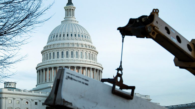 A crowd control fence around Capitol Hill is reenforced with concrete barriers on Jan. 7, 2021, in Washington, DC (BRENDAN SMIALOWSKI/AFP via Getty Images)