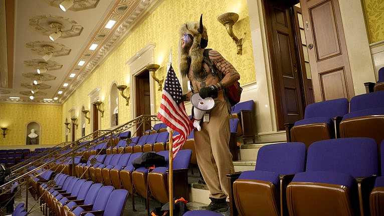 A Trump supporter yells inside the Senate Chamber on Jan. 06, 2021 in Washington, DC (Win McNamee/Getty Images)