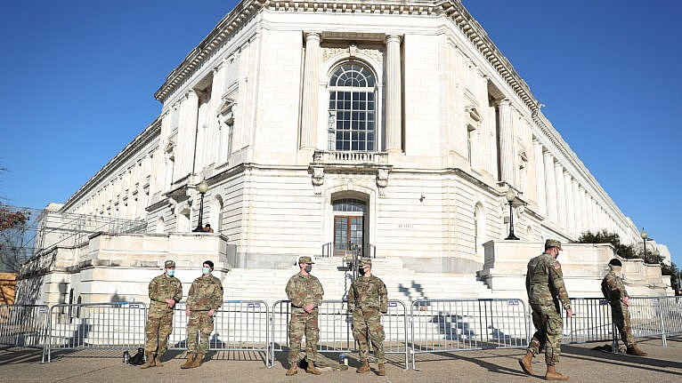 Maryland National Guard members stand guard around the Russell Senate Office Building a day after a pro-Trump mob broke into the U.S. Capitol Building on Jan. 07, 2021 (Joe Raedle/Getty Images)