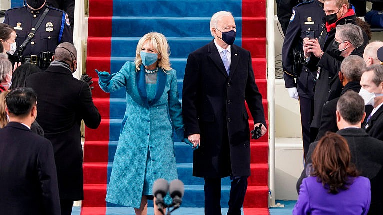 US President-elect Joe Biden flanked by wife Dr. Jill Biden arriving for his inauguration as the 46th US President on January 20, 2021, at the US Capitol in Washington, DC. (Patrick Semansky AFP/Getty Images)