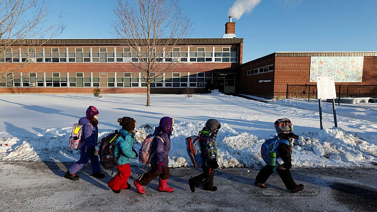 Students return to in-class learning after a four-week lockdown at Vincent Massey Public School in Ottawa, on Feb. 1, 2021 (Blair Gable/Reuters)
