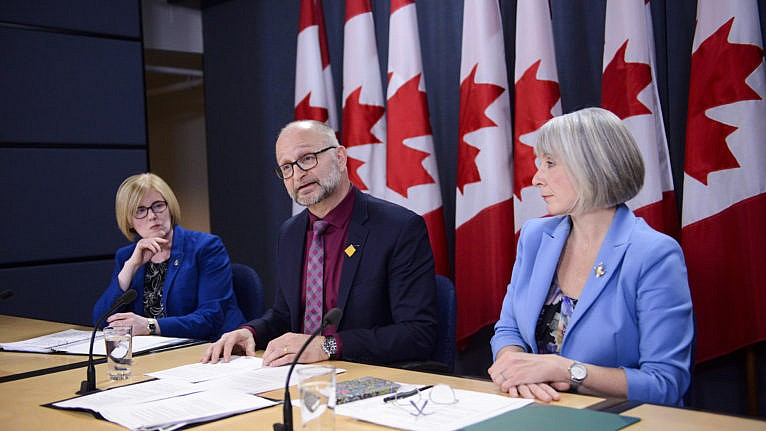 Federal ministers attend a press conference in Ottawa last year when the government was asking a judge to extend the deadline for revising its law on medical aid in dying (CP/Sean Kilpatrick)