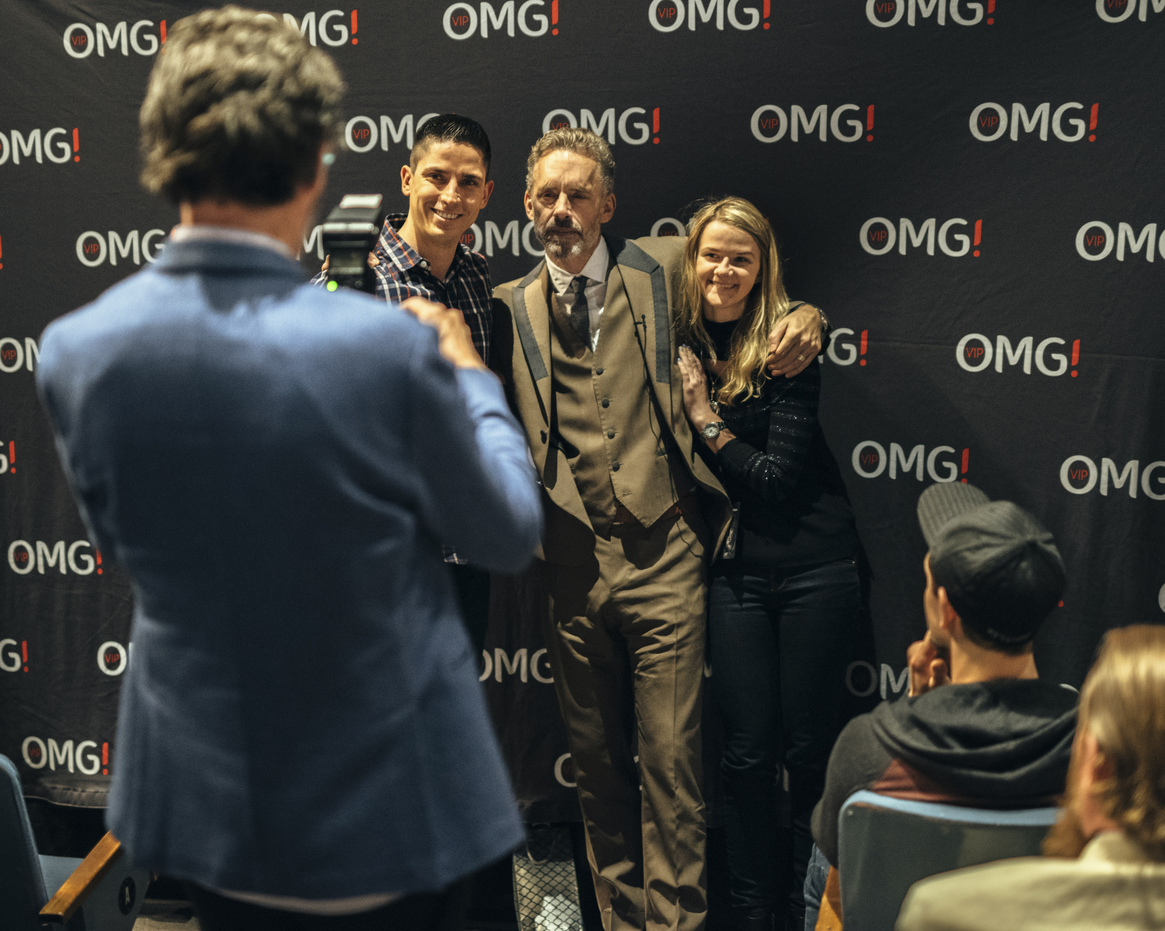 Fans are photographed with Peterson (Mark Sommerfeld/The New York Times/Redux)