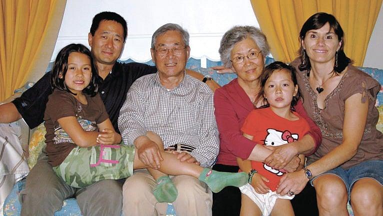 Nai Nai (third from right) and the author (far right) with their family (Courtesy of Ingrid Littmann-Tai)