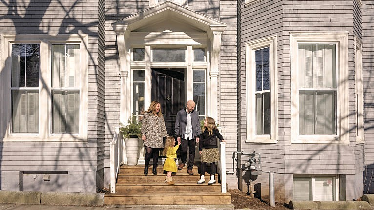 Melissa Mahoney and her family stand in front of their home in Halifax, Nova Scotia. (Photograph by Carolina Andrade)