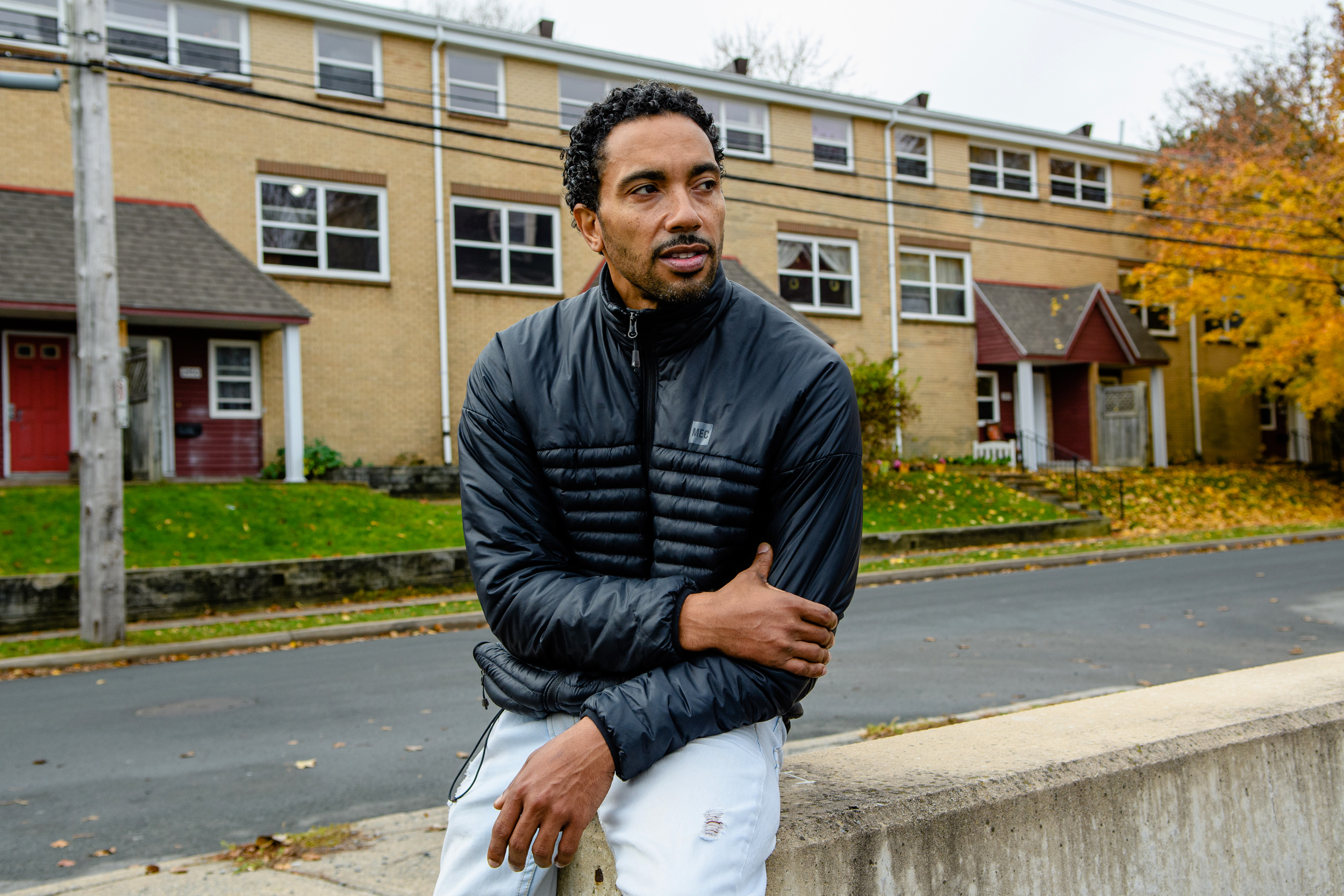 Rodney Small, Director of Common Good Solutions Inc. and One North End in front of Uniake Square, a public housing residential area in North End Halifax NS. (Aaron McKenzie Fraser)