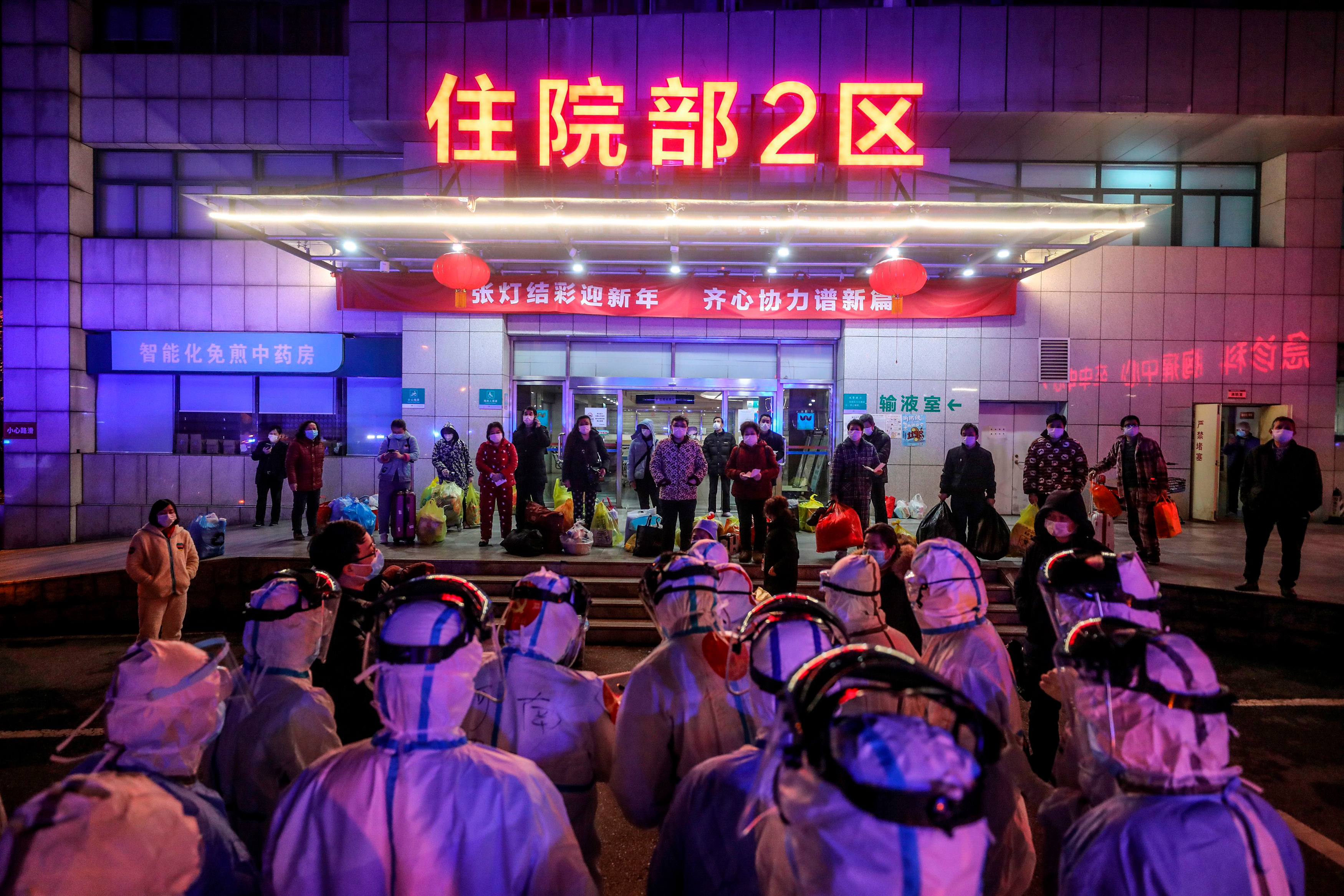 Coronavirus patients wait to be transferred to a newly built hospital in Wuhan, China, in early March 2020 (STR/AFP/Getty Images)