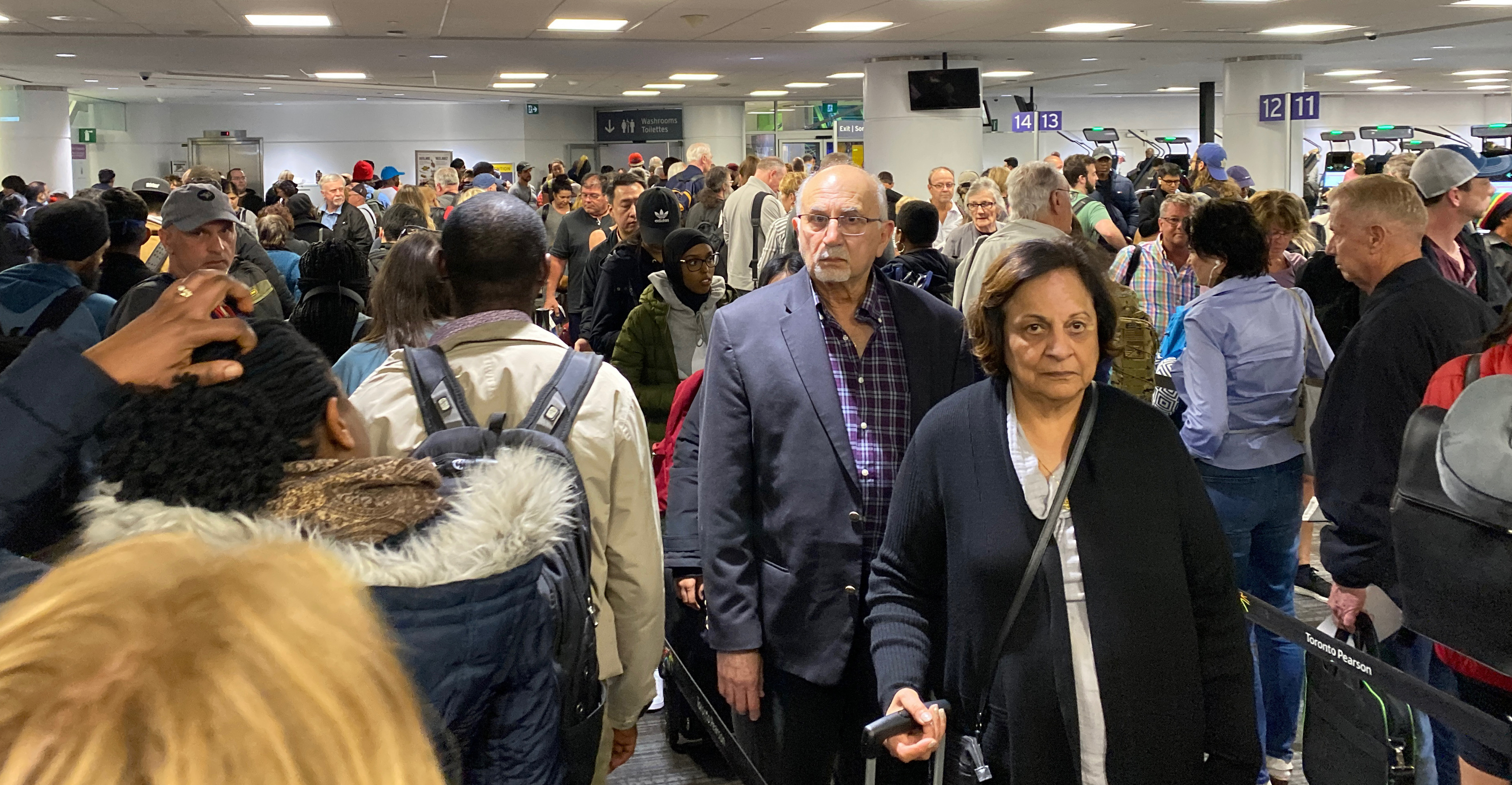 Toronto's Pearson International Airport, on March 14, 2020, was packed with crowds of unmasked people as Canadians returned home (Glen Canning)