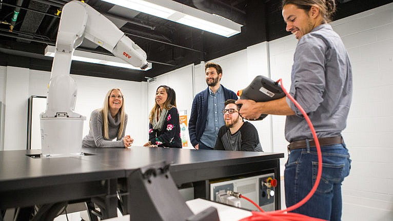 Trois Rivieres University students in a lab