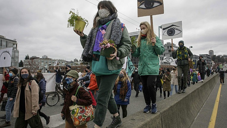 People march during a climate change protest in Vancouver on March 27, 2021 (Liang Sen/Xinhua via ZUMA Press)