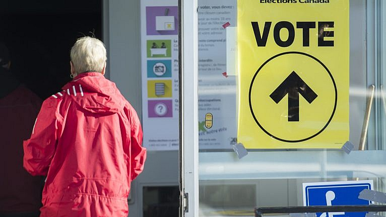 People arrive to cast their ballots at a polling station on federal election day in Shawinigan, Que., on Oct. 21, 2019 (CP/Graham Hughes)