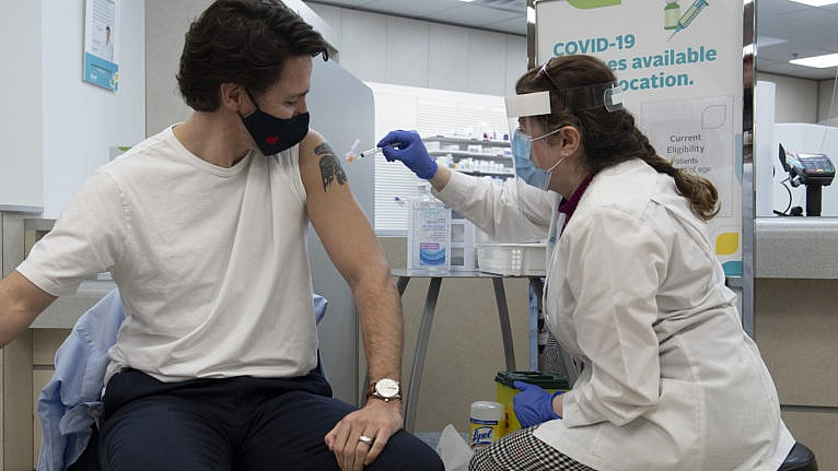 Prime Minister Justin Trudeau receives his COVID vaccination in Ottawa, Friday April 23, 2021. THE CANADIAN PRESS/Adrian Wyld