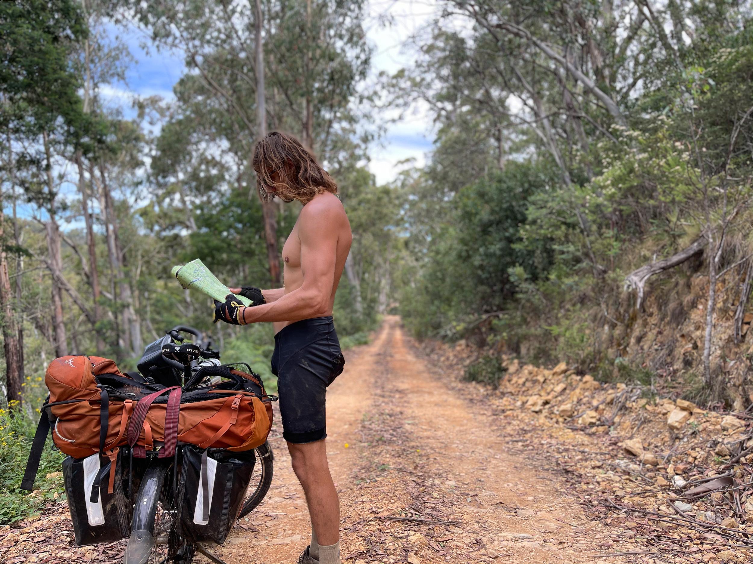 Keddy checks a map at a spot south of Mount Terrible (Layton Keddy)