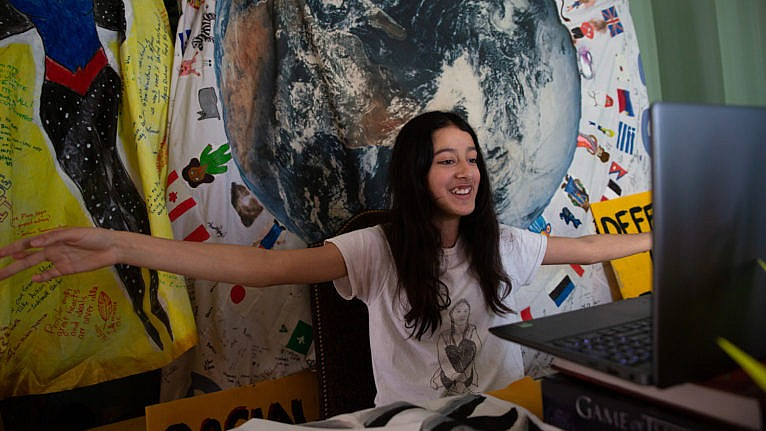 Mathur welcomes guests to a virtual Earth Day event (Photograph by Vanessa Tignanelli)