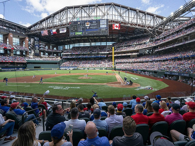 Fans fill the stands at Globe Life Field during the first inning of a baseball game between the Texas Rangers and the Toronto Blue Jays, Monday, April 5, 2021, in Arlington, Texas. The Rangers are set to have the closest thing to a full stadium in pro sports since the coronavirus shutdown more than a year ago. (Jeffrey McWhorter/AP/CP)