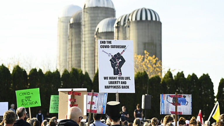 People gather to protest mandatory masks at a anti-mask demonstration during the COVID-19 pandemic in Aylmer, Ont., on Saturday, November 7, 2020. The town declared a state of emergency regarding the issue. (Nathan Denette/CP)