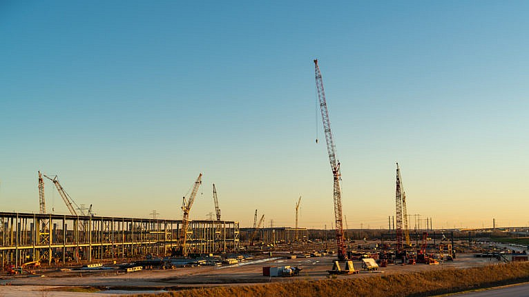 Cranes and large steel columns at Tesla GigaFactory under construction in Austin Texas on Jan. 4, 2021 (iStock)