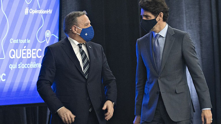 Legault and Trudeau chat after announcing high speed internet for Quebec regions on March 22, 2021, in Trois-Rivieres, Que. (Jacques Boissinot/CP)