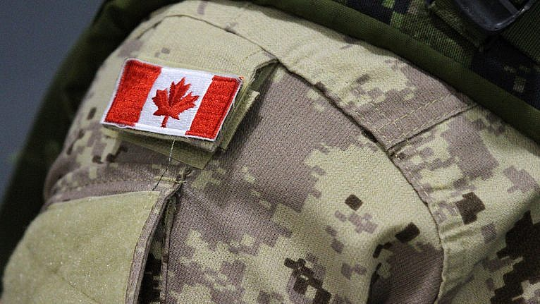 A Canadian Forces member at CFB Trenton on Oct. 16, 2014 (Lars Hagberg/CP)