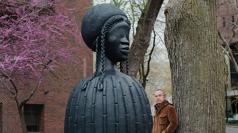 Lum with Simone Leigh's sculpture Brick House on campus at the University of Pennsylvania (Photograph by Hannah Yoon)