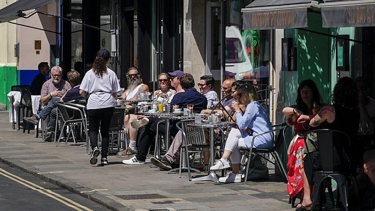 Patrons at a restaurant in Soho, in London. British Prime Minister Boris Johnson delayed the next planned relaxation of coronavirus restrictions in England due to the spread of the delta variant. (Alberto Pezzali/CP)
