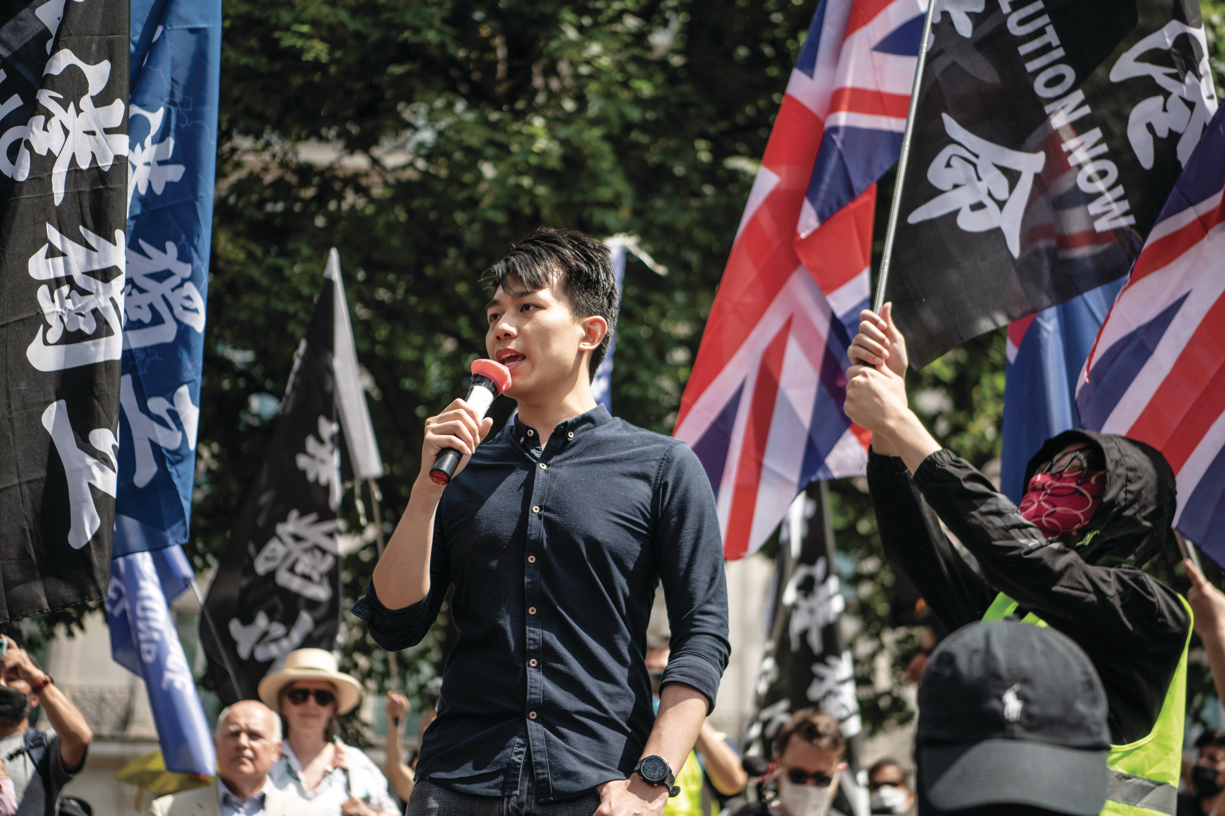 Activist Lau speaks at a rally for Hong Kong democracy in London on June 12, 2021 (Laurel Chor/Getty Images)