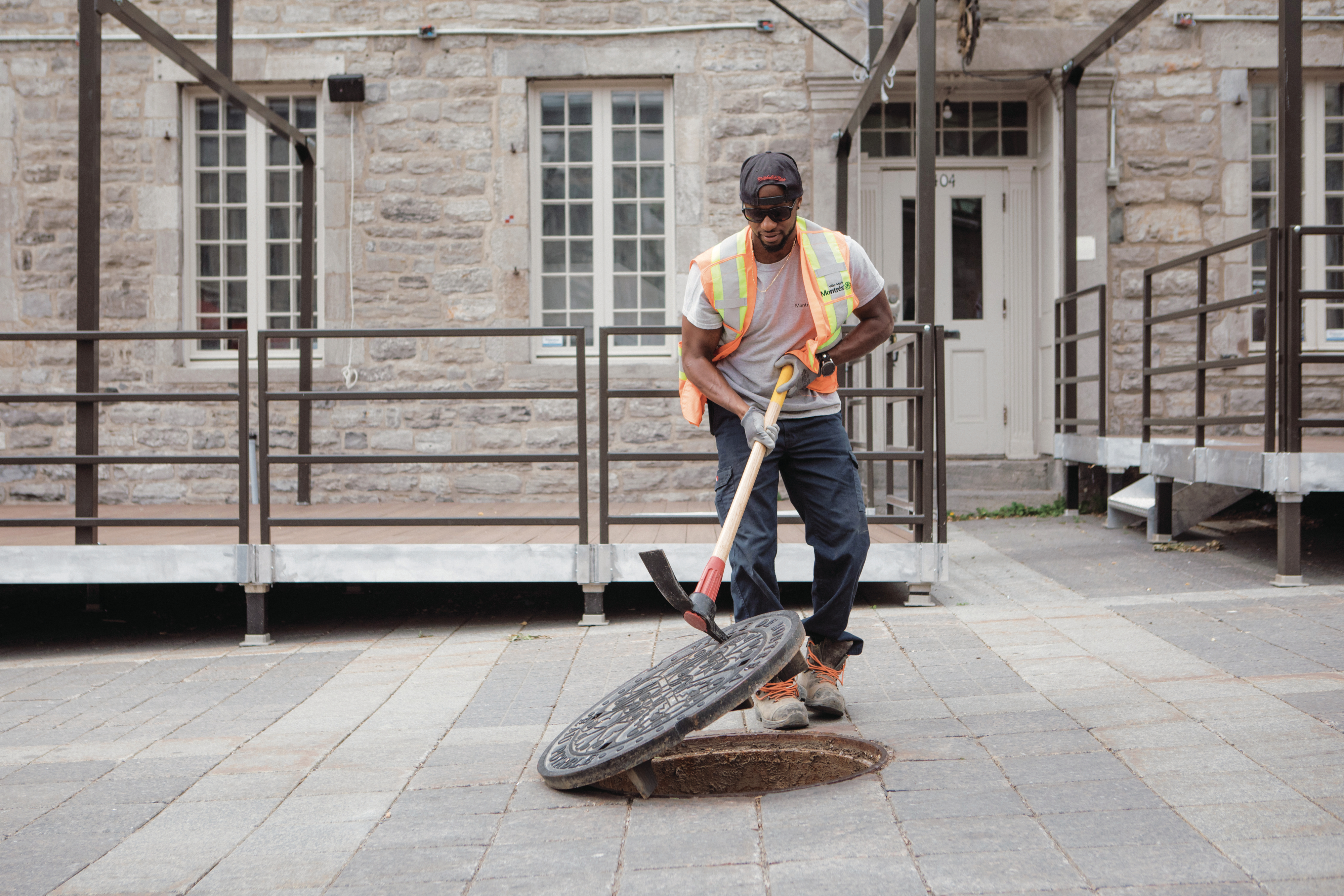A worker installs a manhole cover in the city's Old Port (Photograph by Chloë Ellingson)
