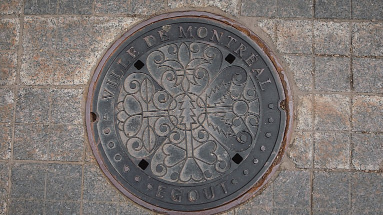 One of Montreal's new manhole covers (Photograph by Chloë Ellingson)