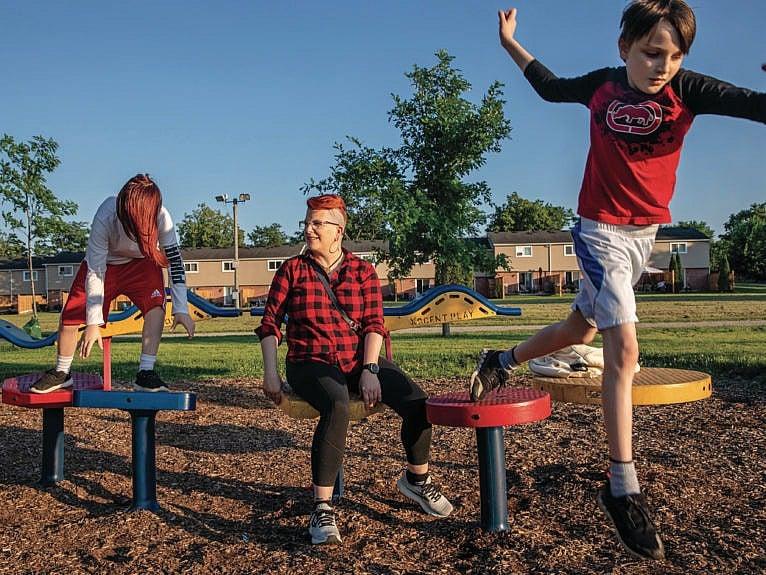 DesRosiers (centre) and their children, Aiden (left), 13, and Easton, 11, in Kitchener, Ont. (Photograph by Brett Gundlock)