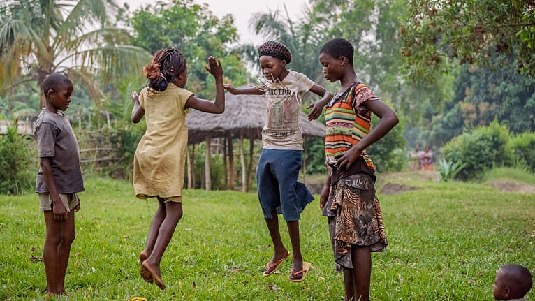 Marie - child in the DRC playing a game