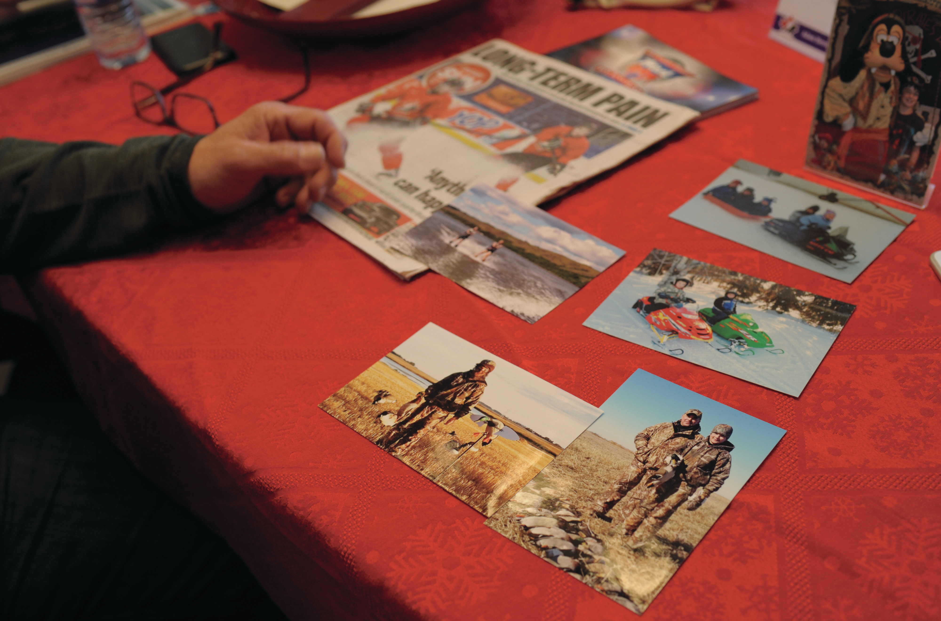 Russell Herold goes through family photos (Photograph by Mark Taylor)